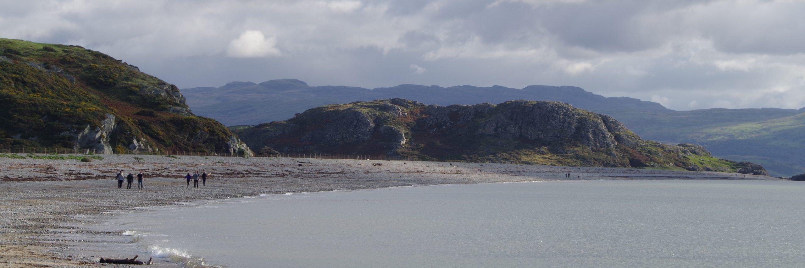 Walk the stony beach