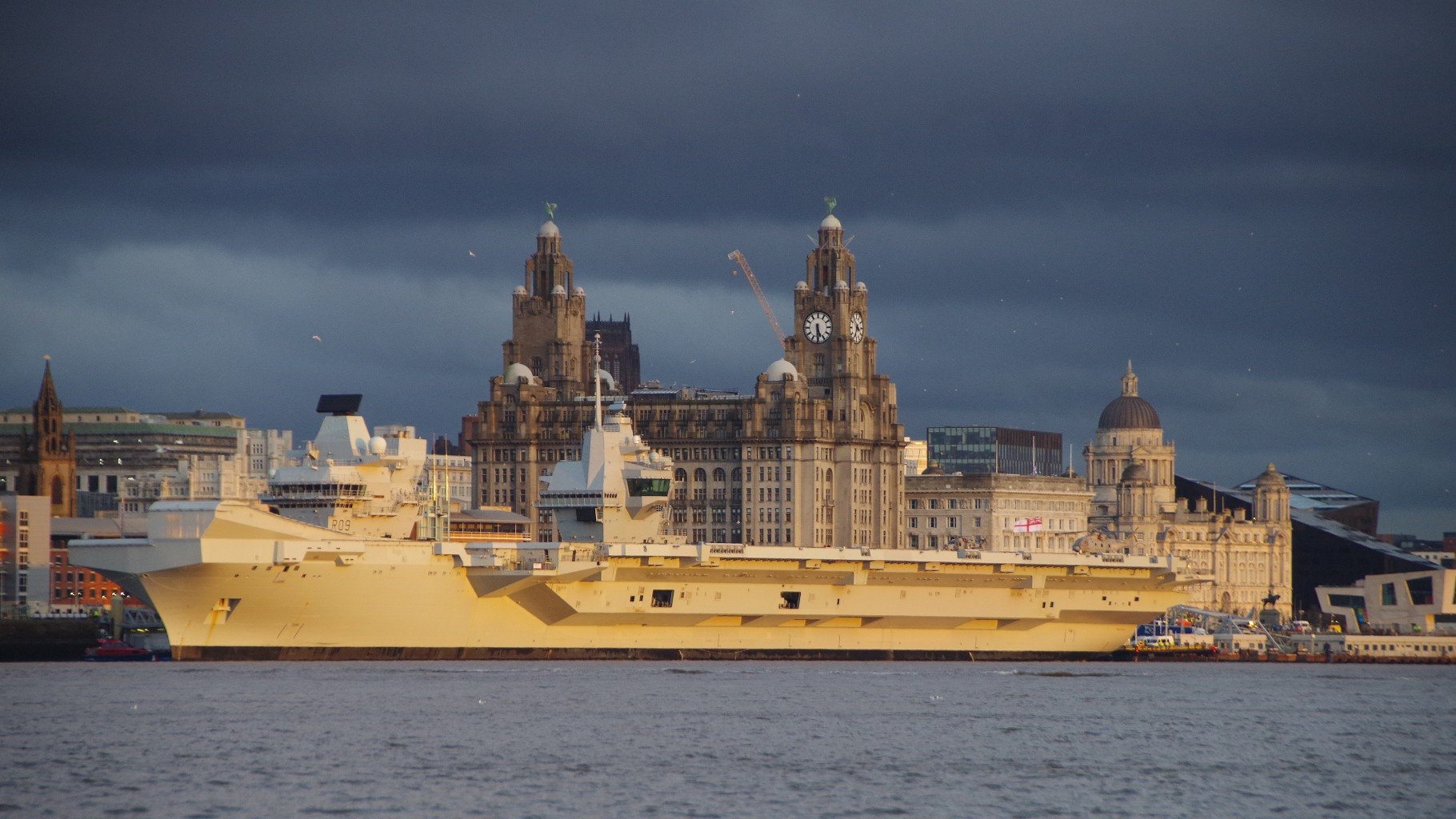 HMS Prince of Wales docked in front of the Liverbuildings