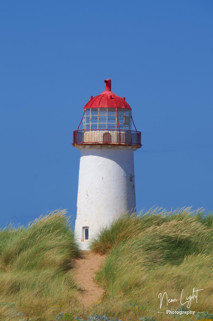 Point of Ayr Lighthouse through the dunes