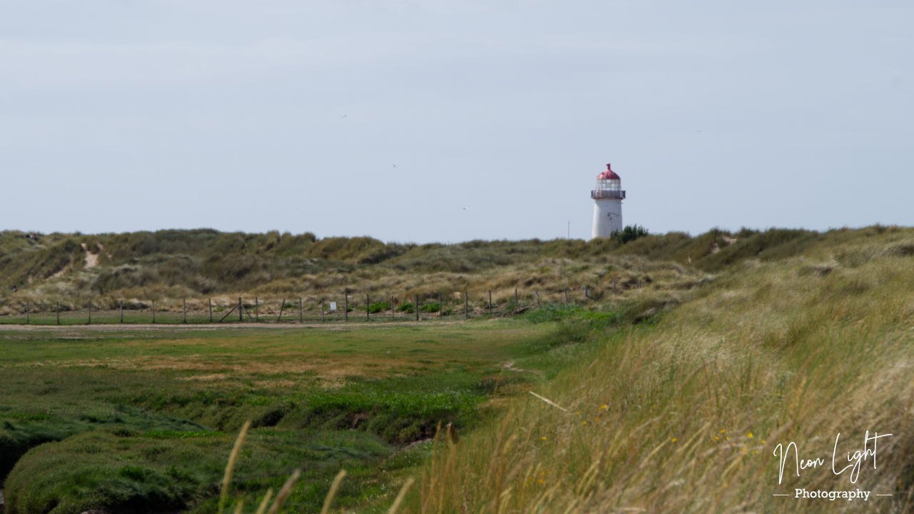 Lighthouse beyond the dunes at Talacre Beach