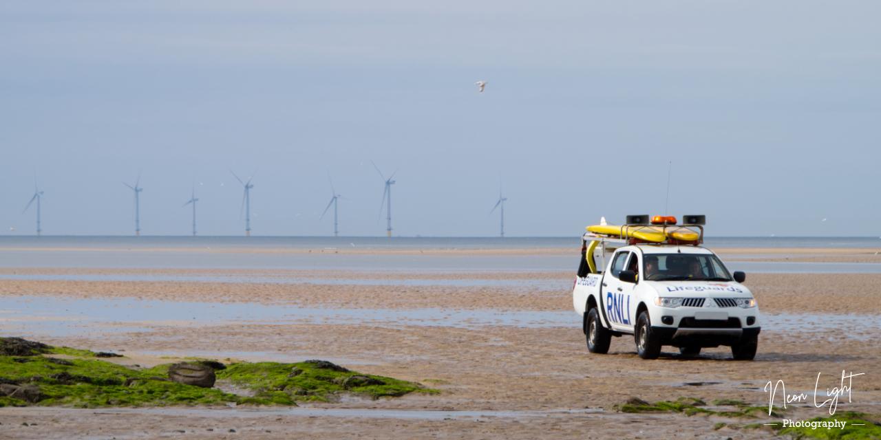 RNLI Lifeguards on West Kirby Beach near Hilbre Island